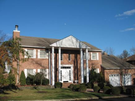 Solid brick four bedroom custom built center hall colonial with two car garage