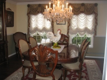 Formal dining room with custom window treatments