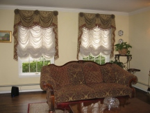 Formal living room with custom window treatments
