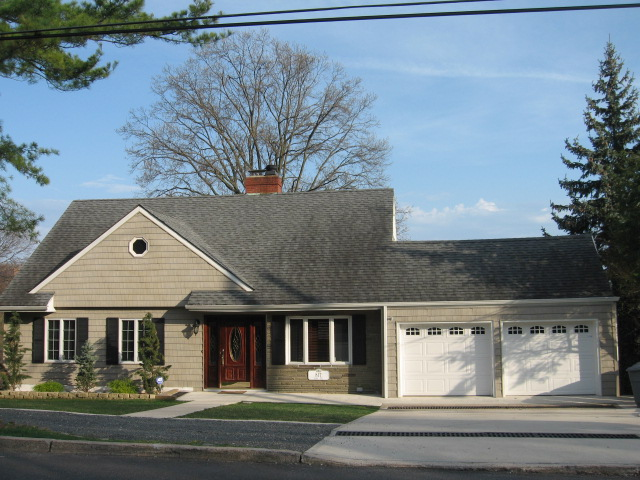 Front of 817 Bard Ave, with two car garage and circular driveway