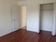Bedoom with new pergo flooring and nice size closet