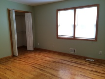 Hardwood and closet in living room